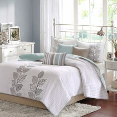 Refresh your master suite or guest room with this lovely coverlet set, showcasing subtle stripes and an embroidered leaf motif.  Pro...