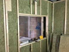 Walls filled with Rockwool control room through to live room at Cedar West Studio, Leeds