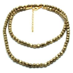 Woman's Choker Necklace Found in Our Coachella Festival Collection>> Hand strung in Ethiopia >> Made of authentic Ethiopian brass or silver beads >> Necklace can be double wrapped and worn as a choker >&gt