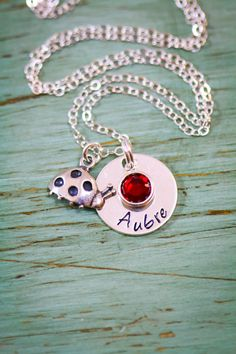 Silver Ladybug Necklace • Sterling Ladybug • Ladybug Charm • Personalized Girls Name • Cute Necklace • Little Girls Gift • Easter Giftcu  Personalized ladybug necklace in Sterling Silver with personalized handstamped girls name, by ReflectionsbyIvy on Etsy. Sterling Silver handstamped name disc necklace and a lovely ladybug charm and birthstone - this name necklace makes a great gift for graduation, birthday, or a new big sister! Personalized to the name and birthstone of your choice.  ✤…