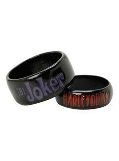 "Metal and enamel ring set with ""The Joker"" & ""Harley Quinn"" designs."