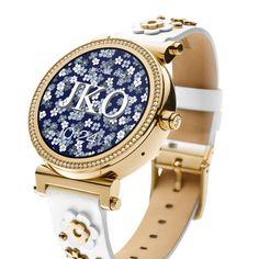 Close-up of gold smartwatch with custom Michael Kors watchface design