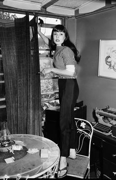 Dorothy Adamson: A modern1958 girl smokes lady cigars,hammers stuff while standing on a chair and is still fashion flawless.