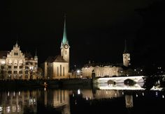 fraumunster and st. peter church in the night