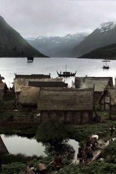 Viking village on edge of fjord .