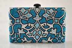 This exquisite hand crafted Swarovski Crystal Bridal clutch has been adorned in a multitude of crystals that all complement each other. The