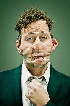 People with their faces wrapped in Scotch tape.
