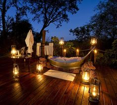 This is too dreamy and glorious... bubble bath, lanterns, summer night.