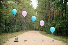 Gender reveal. Would be cute to have the whole family but just put the balloons above the new baby's shoes.