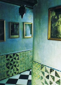The Tangier home of architect and interior designer Roberto Peregalli. Black and white antique marble tiles line the floor of the L-shaped entrance, and are echoed among the 18th century Tunisian tiles that decorate the dado.