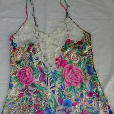 """Vintage Victorias Secret Lace Floral Lingere Slip So beautiful! Gorgeous floral print on a silky material with cream lace detail. In great condition! Size tag says """"P"""" but fits like a small/medium :) PINK Victoria's Secret Intimates & Sleepwear Chemises & Slips"""