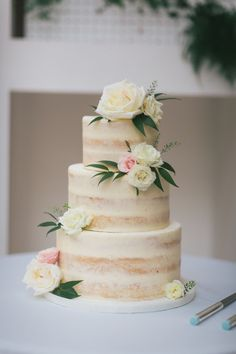simple classic cream and pink half naked wedding cake