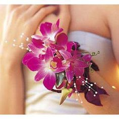The Fushia Orchids Wristlet Corsage will definitely make you stand out at prom. The beautiful purple orchids and lustrous pearl beads will give your dress a tropical feel. Purple Orchid Wedding, Orchid Bouquet Wedding, Corsage Wedding, Purple Orchids, Prom Corsage, Purple Flowers, Floral Wedding, Cake Flowers, Bouquet Flowers