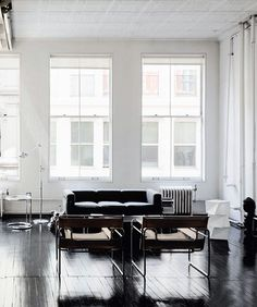 Studiolo | Soho Loft, Marcel Breuer chairs, dark stained wood floors, white walls