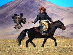 These guys are awesome. They live in the mountains and hunt with eagles that they are companions with for life.