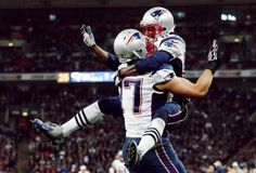New England Patriots Brandon Lloyd (R) celebrates his touchdown against the St. Louis Rams with teammate Nate Solder