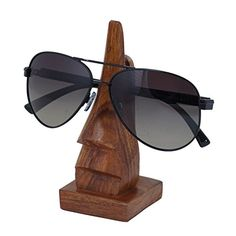 Fine Craft India Handmade Wooden Nose Shaped Spectacle / Specs / Eyeglass Holder /stand Fine Craft India http://www.amazon.in/dp/B013RQRPEM/ref=cm_sw_r_pi_dp_IGQYvb14GPC7R