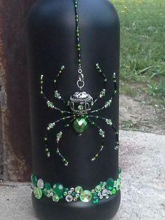 Green Beaded Spider with jeweled bottle.  https://www.facebook.com/arachnobeadia