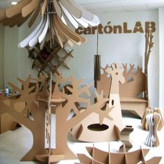 The guys at cartonLAB (part of Moho Architects in Murcia, Spain) create everything from toys and furniture to store displays and DJ stands from cardboard. Diy Cardboard Furniture, Cardboard Box Crafts, Cardboard Design, Cardboard Display, Cardboard Sculpture, Cardboard Paper, Paper Crafts, Cardboard Chandelier, Pop Design