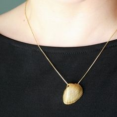 Craft a memorable necklace out of a vacation souvenir: a seashell.    Oh hey, I already have this. :)