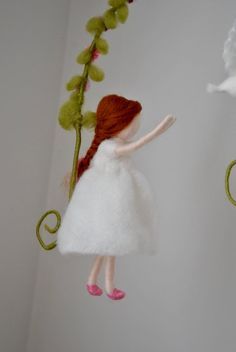 This is a Waldorf inspired piece made of wool by the needle-felting technique. Its been created to provide a peaceful and harmonious image that communicates with the soul through its colors, textures, forms and energy. Dimensions: 12in height, 8 in width. Doll: 6.5in. SHIPPING: Since