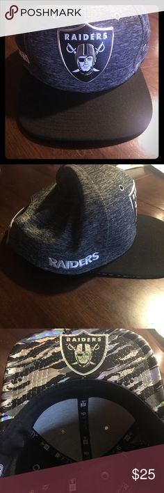 Raiders 9Fifty SnapBack Youth size Hat Oakland Raiders Youth gray/Black SnapBack 9Fifty hat. On smallest measures 21.5 inches, on widest measures 23 inches.  Only worn twice. Like New Condition. New Era Accessories Hats