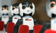 Robi robots on display in Tokyo. They may look cute, but increasingly they are taking our jobs.