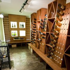 custom wine cellar with LED back lit acrylic display boxes