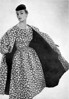 1954 Model in white ottoman print dress with black flowers with accompanying coat, by Balenciaga, photo by Georges Saad