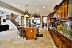 Cipriani Ct. Brentwood, CA $767,000 Eat In Nook with Built In Desk  Oversized Island with Seating for 5 Tile Granite Counters GE Profile Built-In Refrigerator, Dishwasher, Oven, Microwave, 4 Burner Gas Cooktop w/Center Grill, and Trash Compactor Full Length Designer Tile Back Splash with Designer In-Lays Raised Panel Cherry wood Cabinet Doors Gourmet Stainless Steel Range Hood  Walk In Pantry with Glazed Door Travertine Tile Flooring throughout Kitchen #realestate #brentwood homes