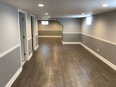 Great job on this finished basement. Two toned gray walls with the chair railing, can lighting, vinyl flooring, and white trim. Two thumbs up! Grey Walls White Trim, Light Grey Walls, Gray Basement, Basement Walls, Grey Flooring, Vinyl Flooring, Two Tone Walls, Basement Painting, Grey Walls Living Room
