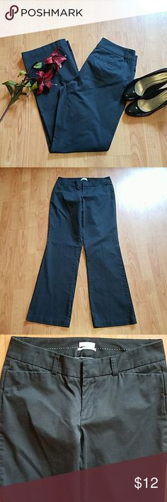 Dockers mid-rise curvy 10 long black dress pants These pants have been worn but are  in excellent condition. The waist measures at 16 in across, there is a 10 inch rise, and the inseam is 34 in. Dockers Pants Boot Cut & Flare