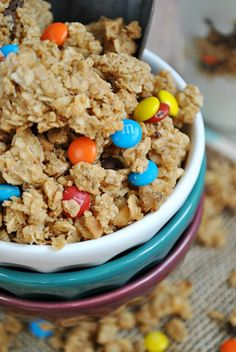 Monster Cookie Dough Granola  - oats, peanut butter, honey, mini chocolate chips and m&ms
