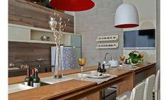 Um espaço amplo e minimalista, onde grandes encontros com amigos acontecem. Um ambiente descontraído e agradável que permite ao anfitrião servir uma refeição e interagir com os convidados.