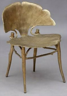 The Ginko leaf is a great Art Nouveau motif, as is the Iris. This is a pretty cool chair.