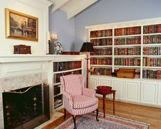Пространственное ощущение домашней библиотеки, обставленной современной мебелью