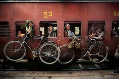 Bicycles hanging on the side of a train, West Bengal, India, Photographer: Steve McCurry Steve Mccurry, Smartphone Fotografie, Vivre A New York, World Press Photo, Composition Techniques, Afghan Girl, Photo Composition, Photography Composition, Composition Examples