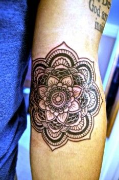 mandala - This particular design is apparently very popular. The one on the girl's back that's partially covered is the same design.