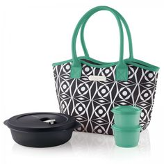 Tupperware Deco Vibe Lunch Bag Set:          Take cool with you wherever you lunch. Let the positive vibes flow as you recharge at lunch with this insulated lunch bag.  Includes Crystal Wave® 4¼-cup/1.1 L Round and two 4-oz./ 120 mL Snack Cups.Black/Green/Snow WhiteLimited Lifetime Warranty on TupperwareQuality Warranty for insulated bag    Item:10127796000