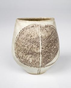 Lucie Rie, Oval vase, stoneware, pale limestone glaze inlaid with manganese sgraffito on either side of pot.