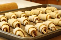 Rugelach - the best Rugelach cookies made with a cheese dough and rolled with a sweet filling of nuts and chocolate, then dusted with powdered sugar.