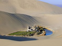 Located approximately 6 km miles) from the outskirts of the city of Dunhuang in Western China, lies Crescent Lake, an incredible oasis in the Gobi desert. Known as Yueyaquan in Chinese, the crescent-shaped lake is a major tourist attraction Places To Travel, Places To See, Places Around The World, Around The Worlds, Beautiful World, Beautiful Places, Crescent Lake, Cresent Moon, Gobi Desert