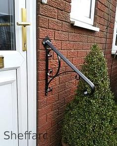 This is a heavy solid steel handrail with flared ornamental scrolled end with ornamental wall fixing plate, the handrail has a curved top and fluted design to it for added style and comfort. It has hand forged scroll infill to add to its stylish look. Wrought Iron Handrail, Iron Handrails, Steel Handrail, Wall Mounted Handrail, Mobility Aids, 2 Step, Handrail Ideas, Railings, Ornaments