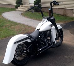 """2002 Harley FatBoy 2"""" Arlen Ness Slam Kit w/ Drop Kick Stand, Black Powder Coated 60 Spoke Twisted Spoke Wheels, 18"""" Rear Wheel, 21"""" Front, Le Pera Seat, Klock Werks Bench Mark 21"""" Front Fender, Bench Mark Smooth 4"""" Stretched Rear Fender, Harley Davidson Freight Train Head Light Nacelle, Carlinni 16"""" Tall 1.5"""" Ape Hangers w/ High Roller Risers, Gloss Black Powder Coated everything Denim White Powder Coated Tins, Vance & Hines Short Shots, Kuryakyn Curved Side Mount Plate with LED tail light"""