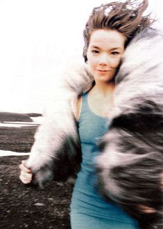 Bjork - 1994. Photo: Stéphane Sednaoui. I love this, the childlike stance works alongside her playful and ecstatic voice.