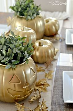 You'd never know by looking at them, but these gilded, Spray Painted Pumpkin Centerpiece beauties are from the dollar store.