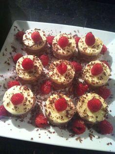 Mini chocolate & vanilla cheesecakes with dark chocolate and raspberry garnish