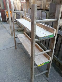 Shelf unit made from reclaimed, sanded and waxed scaffold boards and sections of a wooden ladder