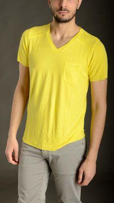 Yellow linen slub T-shirt featuring V neck, slim fit, chest pockets, raw cut detail.