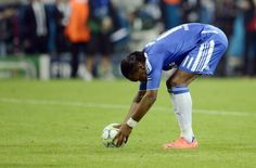 Chelsea's Ivorian forward Didier Drogba places his ball during the penalty session of the UEFA Champions League final football match between FC Bayern Muenchen and Chelsea FC on May 19, 2012 at the Fussball Arena stadium in Munich.